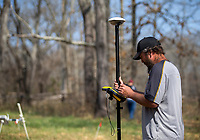 NWA Democrat-Gazette/JASON IVESTER<br /> Michael Evans with the Arkansas Archeological Survey checks GPS coordinates over a grid in the area of the Leetown Hamlet Thursday, March 23, 2017, at the Pea Ridge National Military Park.