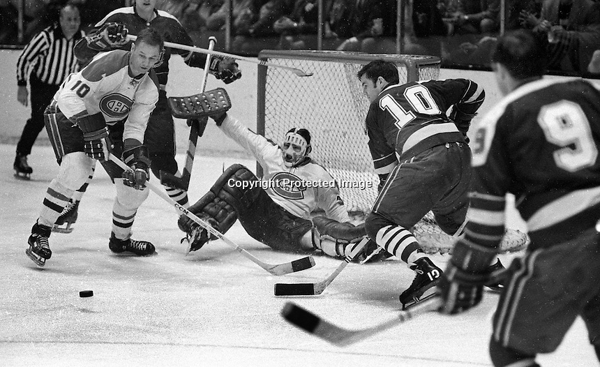California Golden Seals action, Ted Hampson and Bill Hicke, against Montreal Canadiens goalie Ken Dryden and #10 Bill Colins. (1970 photo/Ron Riesterer)