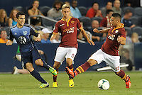 Sporting Park, Kansas City, Kansas, July 31 2013:<br /> Tony Beltran (2) defender MLS All-Stars watches his cross go pass Gianluca Caprani.<br /> MLS All-Stars were defeated 3-1 by AS Roma at Sporting Park, Kansas City, KS in the 2013 AT &amp; T All-Star game.
