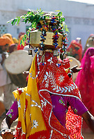 Veiled dancer at a festival in Nalu Village, Rajasthan, India.