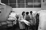 Winter of Discontent London. Family and friensd come in to help those staff not striking in the hospital laundry room. 1979