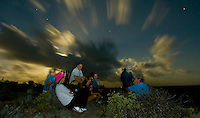 Hikers watching the moonrise<br /> Full moon hike<br /> Ram Head Trail past Salt Pond Bay<br /> St. John<br /> U.S. Virgin Islands