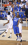 UK center Dakari Johnson (44) blocks UConn forward DeAndrew Daniels (2) during the NCAA National Championship vs. UConn at the AT&T in Arlington, Tx., on Monday, April 7, 2014. Photo by Eleanor Hasken | Staff