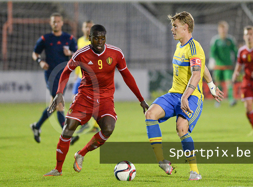20151012 - DEINZE , BELGIUM  : Swedish Eric Smith (16) pictured with Belgian Nany Dimata (9)  during the soccer match between Under 19 teams Sweden and Belgium , on the third and last matchday in group 13 of the UEFA Qualifying Round Under 19 in Deinze , Belgium . Monday  12 th October  2015 . PHOTO DAVID CATRY