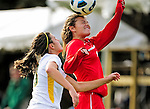14 October 2010: University of Hartford Hawks forward Arielle Aikens, a Freshman from Wantage, NJ, jumps to get a header against University of Vermont Catamount defender Jill Dellipriscoli, a Sophomore from Montpelier, VT,  at Centennial Field in Burlington, Vermont. The Hawks defeated the Lady Cats 6-2 in America East play. Mandatory Credit: Ed Wolfstein Photo