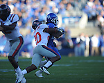 Ole Miss' Aaron Garbutt (20) tackles Kentucky's CoShik Williams (26) at Commonwealth Stadium in Lexington, Ky. on Saturday, November 5, 2011. ..