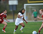 Oxford High's Michelle Reid vs. Lafayette High's Nickie Kesler (8) in girls high school soccer in Oxford, Miss. on Saturday, December 8, 2012. Oxford won 1-0.