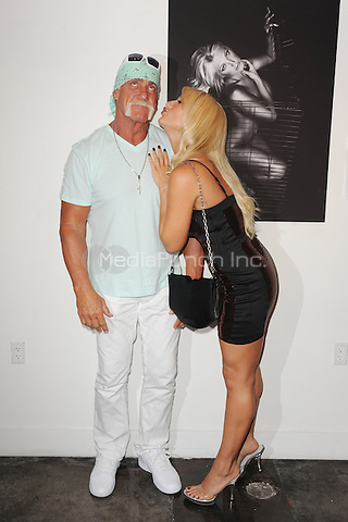 MIAMI, FL - AUGUST 11 : Brooke Hogan, Hulk Hogan  celebrate hulks 58th birthday as photographer Jordan Michael Zuniga debuts his latest works, Women in Cages, at Cafeina on August 11, 2011 in Miami Florida. © MPI04 / Media Punch Inc.