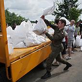 DOBRZYKOW, POLAND, MAY 24, 2010:.Polish soldier carrying sand bags for the anti flood wall..The latest chapter of disastrous floods in Poland has been opened yesterday, May 23, 2010, after Vistula river broke its banks and flooded over 25 villages causing evacualtion of most inhabitants..Photo by Piotr Malecki / Napo Images..DOBRZYKOW, POLSKA, 24/05/2010:.Zolniez niesie worek z piaskiem.  Najnowszy akt straszliwych tegorocznych powodzi zostal rozpoczety wczoraj gdy Wisla przerwala waly na wysokosci wsi Swiniary kolo Plocka..Fot: Piotr Malecki / Napo Images ..