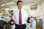 Michihiro Kohno, president and CEO of Yagisawa Shoten, poses with bottles of his soy sauce at the company's temporary premises in Ichinoseki, Iwate Prefecture Prefecture, Japan on 04 Sept. 2011. Photograph: Robert Gilhooly