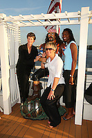 4 April 2008: Stanford Cardinal (L-R) associate head coach Amy Tucker, assistant coach Kate Paye, and assistant coach Bobbie Kelsey during Stanford's 2008 NCAA Division I Women's Basketball Final Four salute dinner at the Tampa Convention Center in Tampa Bay, FL.