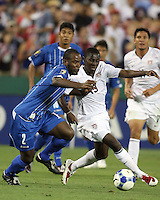 Freddy Adu #19 of the USA pushes away from Osman Chavez #2 of Honduras during a CONCACAF Gold Cup match at RFK Stadium on July 8 2009 in Washington D.C. USA won 2-0.