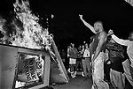 Rioters in downtown Los Angeles set a parking kiosk ablaze near LAPD headquarters in downtown Los Angeles. 4/29/1992