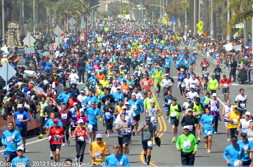 "Thousands of runners cross the finish line in Santa Monica during the 27th Los Angeles Marathon on Sunday, March 18, 2012 The ""Stadium to the Sea"" course kicked off at Dodger Stadium and finish on Ocean Avenue at the intersection of Ocean Ave and California Avenue, just steps from the Santa Monica Pier."