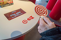 "RFID receiver and token in the Target ""Wonderland!"" pop-up store in the Meatpacking District in New York on its grand opening day, Wednesday, December 9, 2015. According to Target the store combines physical and digital shopping using medallions given to visitors with an embedded RFID chip. Tapping the chip to an antenna near the product lets you order it. The store is an experiment in technology replacing shopping carts with chips.  (© Richard B. Levine)"