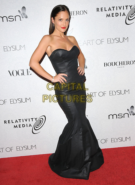 "MINKA KELLY.Art of Elysium 3rd Annual Black Tie charity gala '""Heaven"" held at 990 Wilshire Blvd in Beverly Hills, California, USA, .January 16th 2010 .full length strapless leather black dress long maxi hands on hips .CAP/RKE/DVS .©DVS/RockinExposures/Capital Pictures"
