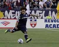New England Revolution defender Kevin Alston (30) kicks a long pass.  The New England Revolution drew FC Dallas 1-1, at Gillette Stadium on May 1, 2010