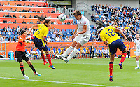 Abby Wambach (C) of team USA and Nataly Arias (l) and Katerin Castro (r) of team Colombia during the FIFA Women's World Cup at the FIFA Stadium in Sinsheim, Germany on July 2nd, 2011.