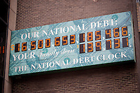 The National Debt Clock in New York  showing the US debt as over $16 trillion is seen on Friday, March 1, 2013.  Real-estate mogul, the late Seymour Durst, created the clock on Feb. 20, 1989 to call attention to  Reaganomics. (© Richard B. Levine)