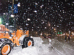 """Falling snow obscures clearing equipment and the street along Rehoboth Avenue, the """"main street"""" of Rehoboth Beach, Delaware, USA, near the end of the Blizzard of February 2010."""