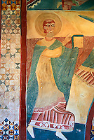 Twelfth century restored Romanesque Frescoes arounf the entrance to the church of Saint Joan of Boi, Val de Boi, Alta Ribagorca, Pyranese, Spain. A UNESCO World Heritage Site