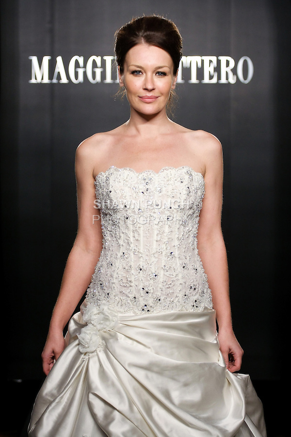 Model walks the runway in a Perla Haute Couture wedding dress from the Maggie Sottero Bridal Spring 2012 collection, during  Couture: New York Bridal Fashion Week 2012