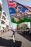 "A participant waves an flag while taking part in a parade during the Kanamara ""Penis"" Festival in Kawasaki, Japan."
