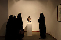 Female college students wearing the chador visit an exhibition at the Tehran Museum of Contemporary Art.