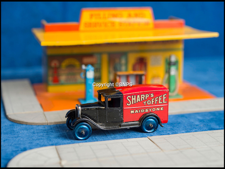 BNPS.co.uk (01202 558833)<br /> Pic: PhilYeomans/BNPS<br /> <br /> Sharps Toffee.<br /> <br /> Dinky dynamite...<br /> <br /> The 'Holy grail' of Dinky car collectors are being sold  at SAS auctions in Newbury - and at &pound;15,000 a set they cost more than the real vans would have back in the day.<br /> <br /> The first two delivery van sets, made in 1933, contain six vans in each -  and amazingly most of the brands are still going strong today, over 80 years later. <br /> <br /> Second ever Dinky van set: Crawfords biscuits, Castrol, Marsh sausages, Meccano, Kodak film and Sharpes toffee.