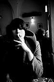 Wroclaw 11.2009 Poland<br /> Transsexual Marina Till in the cafe.<br /> Marina Till, a transsexual, has had numerous medical examinations and treatments, such as a very intense hormonal therapy, at times seriously weakening her organism. For a long time she has been dreaming  about a sex change surgery that she can not afford. She does not accept herself and her body. Frequent suicide attempts and alcohol abuse, are means of escape from the body she lives in. A body that does not belong to her.<br /> Photo: Adam Lach / Napo Images<br /> <br /> Transseksualista Marina Till w kawiarni.<br /> Transseksualista Marina Till przeszla juz setki kuracji hormonalnych i badan psychoterapeutycznych, ktore w znaczny sposob wycienczyly jej organizm. Od wielu lat marzy o zmianie plci lecz najzwyczajniej nie stac ja na zbyt kosztowna operacje. Nie akceptuje siebie, nie akceptuje swojego ciala. Czeste proby samobojcze i znaczne ilosci alkoholu sa dla niej sposobem na ucieczke, przede wszystkim od swiadomosci ze cialo w ktorym zyje nie nalezy do niej.<br /> Fot: Adam Lach / Napo Images