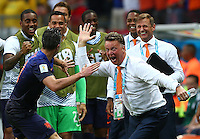 Robin Van Persie of Netherlands celebrates scoring his goal to make it 1-1 with manager Louis Van Gaal