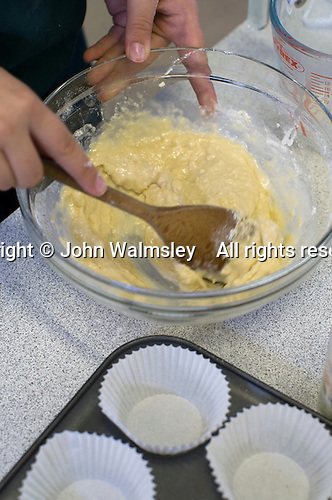 Stirring the cupcake mix, Food Technology class, state secondary School.