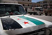 MARAT MISREAN, SYRIA: The opposition flag is painted on the hood of a truck despite the fact that Syrian armed forces are operating  in neighboring cities...A violent struggle between the Free Syrian Army and the Assad regime has been going on for over a year...Photo by Rachel Beth Anderson/Metrography