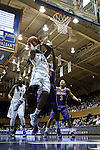 19 December 2013: Duke's Chelsea Gray (12) is defended by Albany's Tammy Phillip (BVI) (14) and Albany's Margarita Rosario (3). The Duke University Blue Devils played the University at Albany, The State University of New York Great Danes at Cameron Indoor Stadium in Durham, North Carolina in a 2013-14 NCAA Division I Women's Basketball game. Duke won the game 80-51.