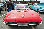 March 31, 2013 - Garden City, New York, U.S. - This red Corvette convertible is at the 58th Annual Easter Sunday Vintage Car Parade and Show sponsored by the Garden City Chamber of Commerce. Hundreds of authentic old motorcars, 1898-1988, including antiques, classic, and special interest participated in the parade.