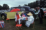 Royal Ascot, picnic in car park No 1. Berkshire England. The English Season published by Pavilon Books 1987. Page 89. Yellow Rolls Royce.