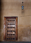 Cairo, Egypt -- A door and lamp in the wall of the Qibla side of the historic ibn Tulun mosque. © Rick Collier / RickCollier.com