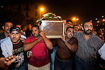 Egyptian Coptic Christians march with the coffin of a victim of sectarian violence October 10, 20011 from the Coptic Hospital in Cairo, Egypt to the Coptic Cathedral a short distance away. At least 26 people, mostly Christian, were killed during sectarian clashes that saw the worst violence since the Revolution that toppled former Egyptian president Hosni Mubarak earlier this year. Egyptian Coptic Christians make up about 10% of Egypt's 80 million population and periodically violence flares between the Christian minority and the majority Muslim population. (Photo by Scott Nelson)