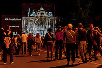 People attend the light painting show displayed on the front of the Hungarian Science Academy building during the Hungarian rotational EU presidency closing celebrations in Budapest, Hungary on June 26, 2011. ATTILA VOLGYI