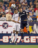 Los Angeles Galaxy defender Sean Franklin (5) and New England Revolution midfielder Chris Tierney (8) battle for head ball. In a Major League Soccer (MLS) match, the Los Angeles Galaxy defeated the New England Revolution, 1-0, at Gillette Stadium on May 28, 2011.