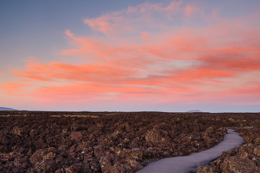 Sun sets on a pathway at Craters of the Moon National Monument.