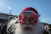 BROOKlLYN, NY - JANUARY 01 : A man wearing 2017 glasses takes  part in the annual Coney Island Polar Bear Club New Year's Day swim by running into the ocean at Coney Island , Brooklyn on January 01, 2017. Photo by VIEWpress/Maite H. Mateo.