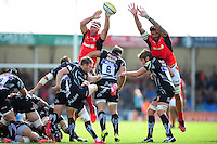 Will Chudley of Exeter Chiefs box-kicks the ball as Schalk Burger and Jim Hamilton of Saracens attempt to charge him down. Aviva Premiership match, between Exeter Chiefs and Saracens on September 11, 2016 at Sandy Park in Exeter, England. Photo by: Patrick Khachfe / JMP