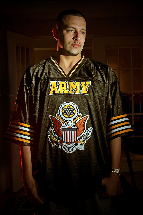 Ian Vaquero, 31, is a young veteran from the Iraq war. He served in the U.S. Army during the invasion of Iraq 2003.This is Vaquero with memorabilia from the war at his home on Thursday May 27, 2010.