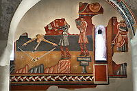 Detail of wall painting (20th century copy),  North wall, Lombard Romanesque style Church of Sant Joan de Boi, 11th century, Catalonia, Spain. This mural represents three males: an acrobat catching swords with his mouth, a juggler and a musician playing the harp. They represent the celebration of the celestial universe and the music and joy enjoyed by the blessed. The murals are now preserved at the National Museum of Catalan Art (MNAC) in Barcelona. Picture by Manuel Cohen.