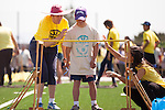 Daniel Night participates in the steeplechase with the help of volunteers at the 35th annual Kiwanis Special Games May 17.