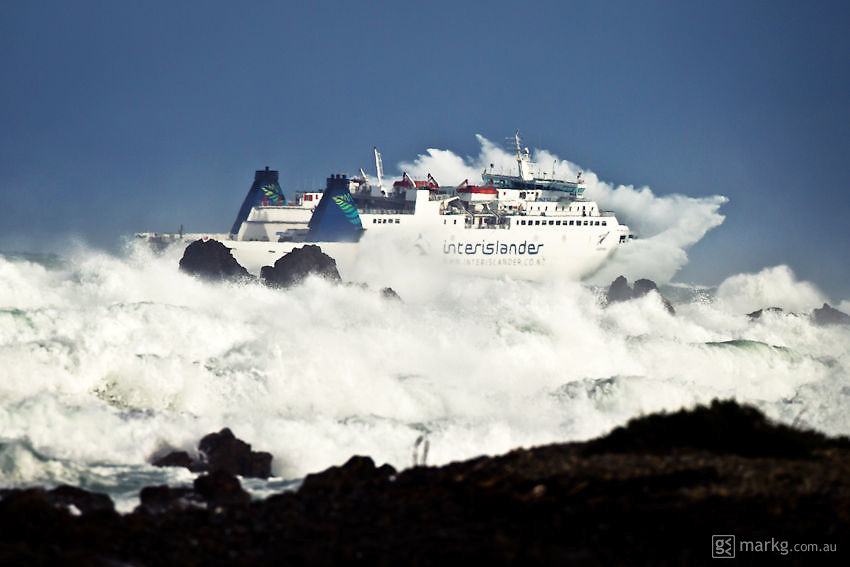 The Interislander Ferry, Aratere, battles it's way through huge seas as it makes it's way out of Wellington Harbour to cross the Cook Strait en route to Picton on the South Island of New Zealand. The photo was taken at 2.32pm on the 9th August 2010.