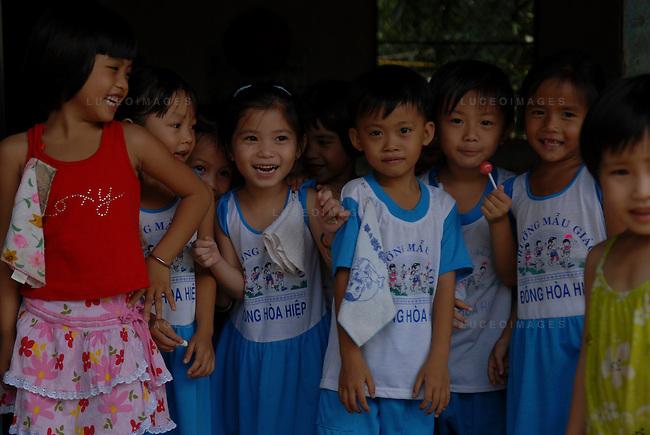 Vietnamese children in their school in Can Tho, Vietnam.