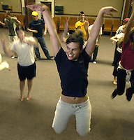 Choreographer Liz Filichia, demonstrates a step she wants dancers to perform during a rehearsal for the The Light, an East Valley sing and dance group. The 23 member group is trying to raise enough money to take part in a competition in New York (Rick D'Elia)