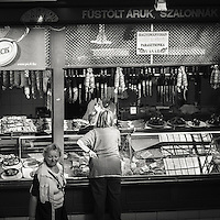 Women shopping at the butcher in one of the shopping senters in central Budapest Hungary
